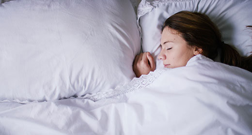 Young woman sleeping peacefully in bed